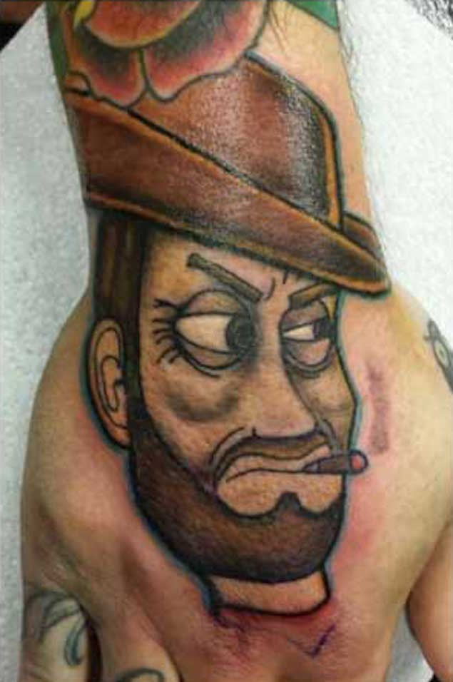 Sharp homemade watercolor smoking toy cowboy tattoo on hand