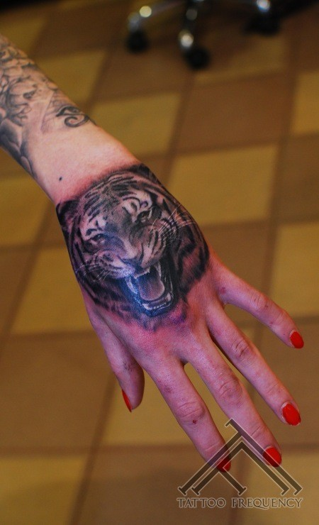 Sharp painted detailed black and white roaring tiger tattoo on arm