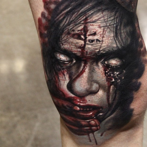 Sharp painted very realistic horrifying bloody monster tattoo on arm