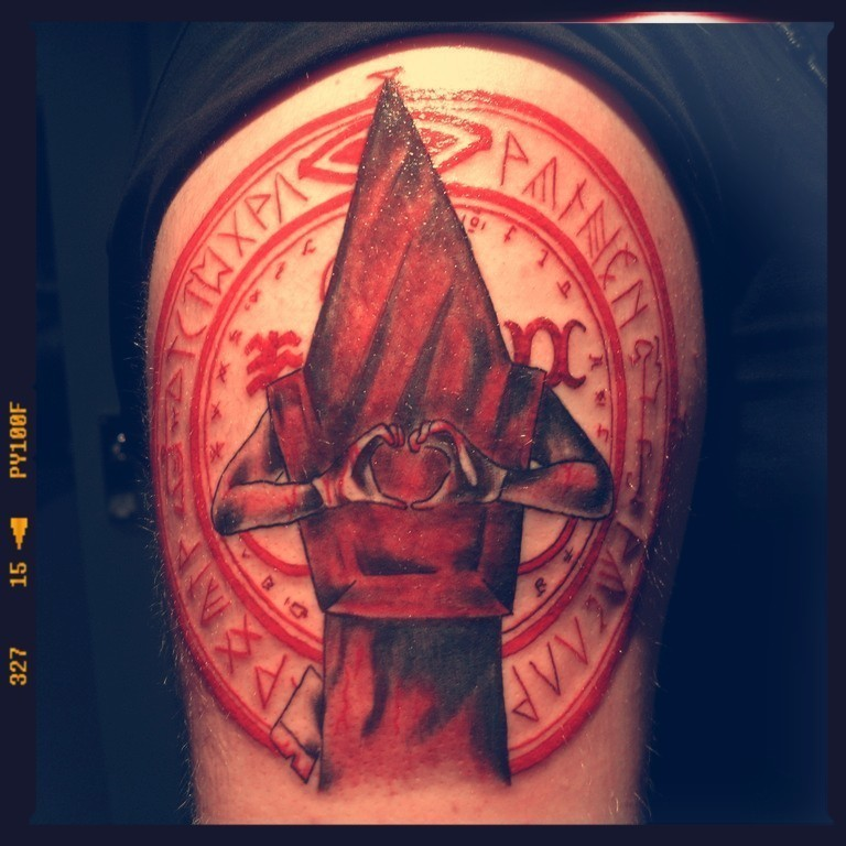 Sharp red colored big mystical shoulder tattoo of Silent Hill monster with cult circle