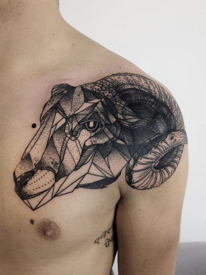 Sheep head black ink tattoo on shoulder