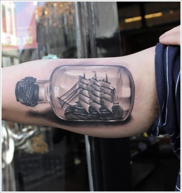 Ship in a sealed bottle tattoo on arm
