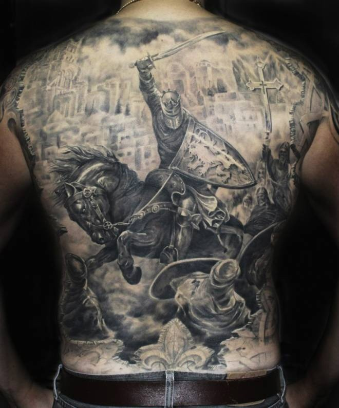 Significant detailed massive black ink medieval knight tattoo on whole back