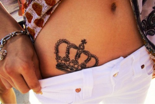 Simple and cool crown tattoo on belly