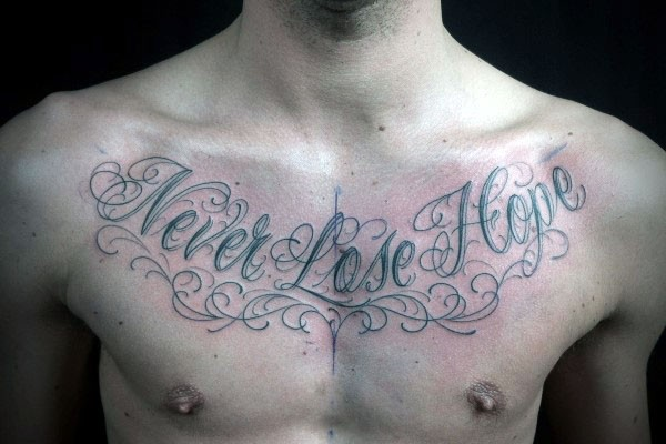Simple beautiful colored lettering tattoo on chest
