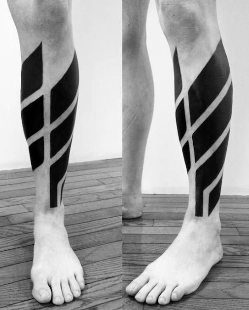 Simple big black ink ornament tattoo on leg