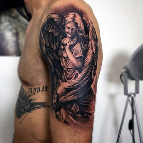 Simple black and white cute angel woman tattoo on upper arm