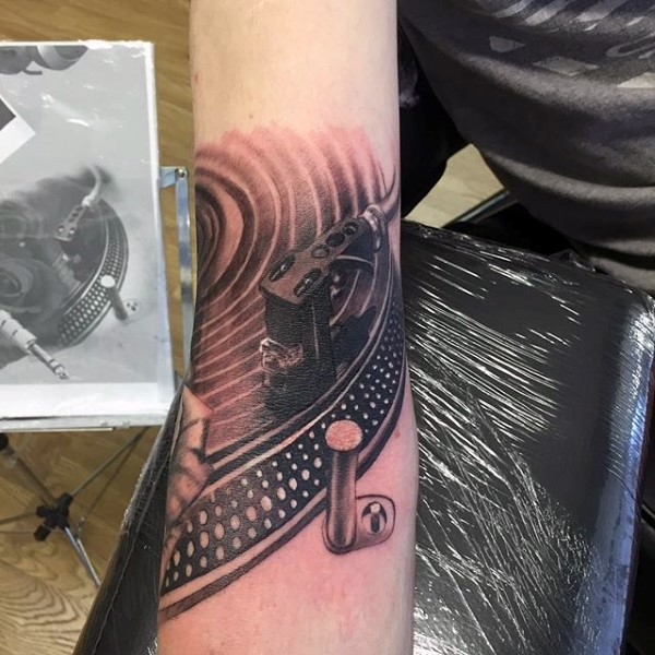 Simple black and white detailed vinyl player tattoo on arm