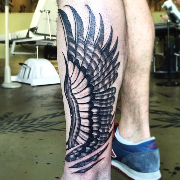 Simple black and white eagle wing tattoo on arm