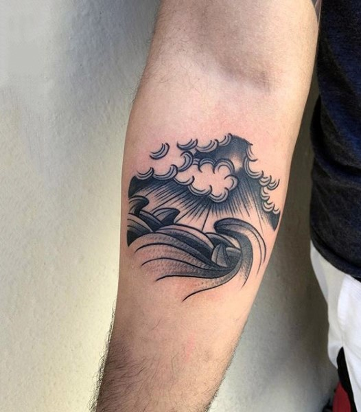 Simple black and white homemade like waves tattoo on arm