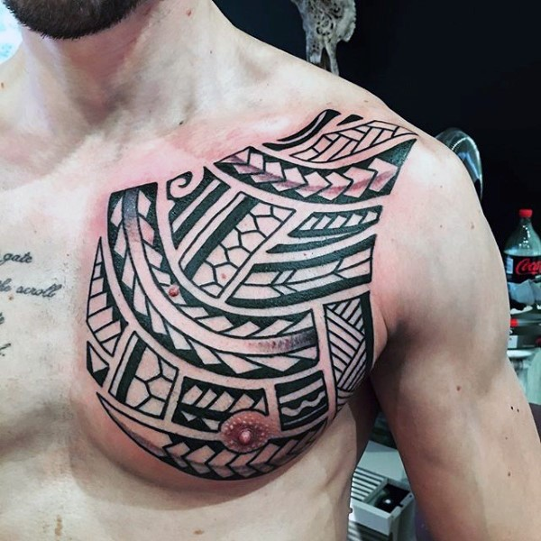 Simple black and white polynesian style tattoo on chest for Simple chest tattoos for guys