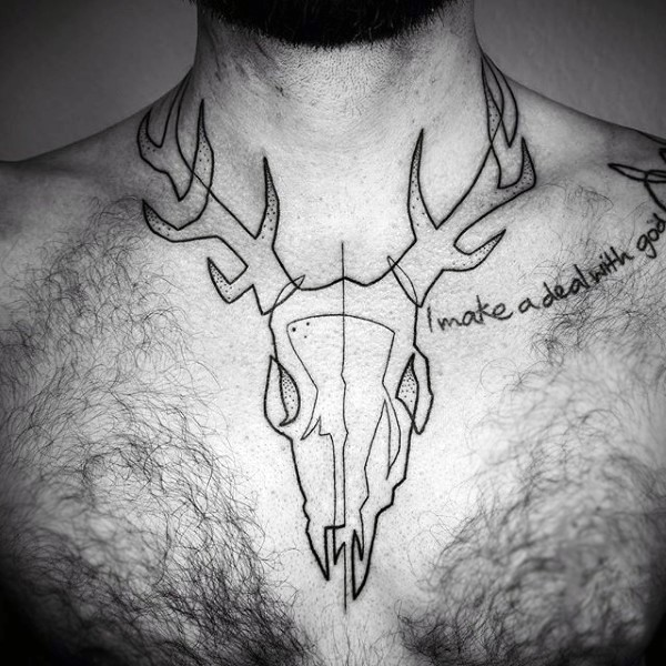 Simple black ink animal skull with lettering tattoo on chest