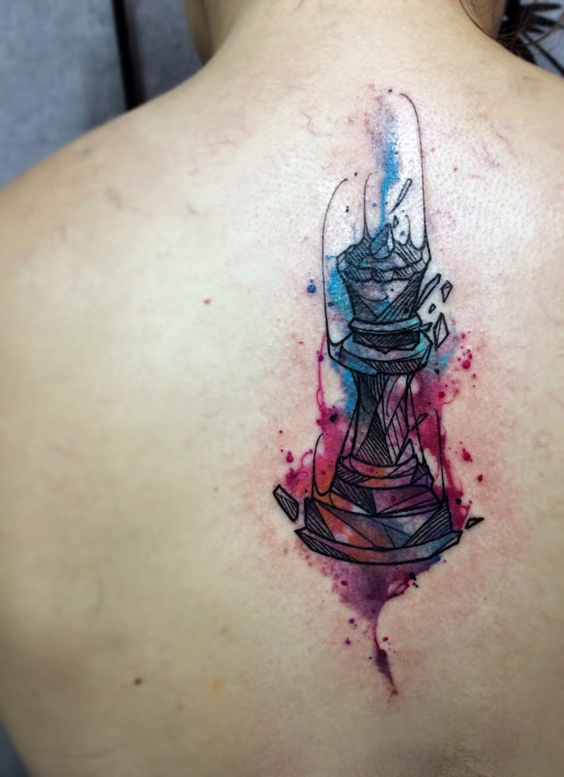 Simple black ink back tattoo of broken candlestick
