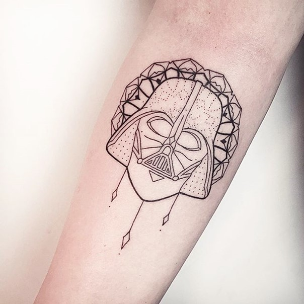 Simple black ink Darth Vader mask pattern tattoo on forearm