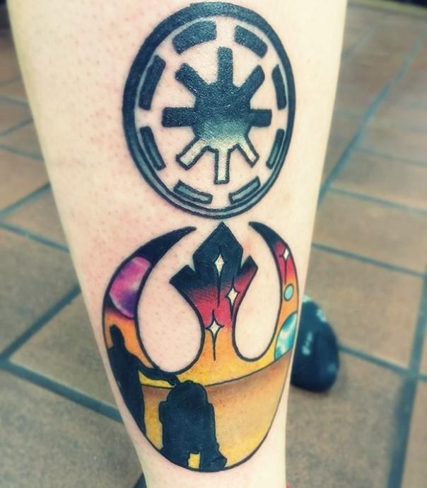 Simple black ink Empire emblem tattoo on leg with Rebel emblem