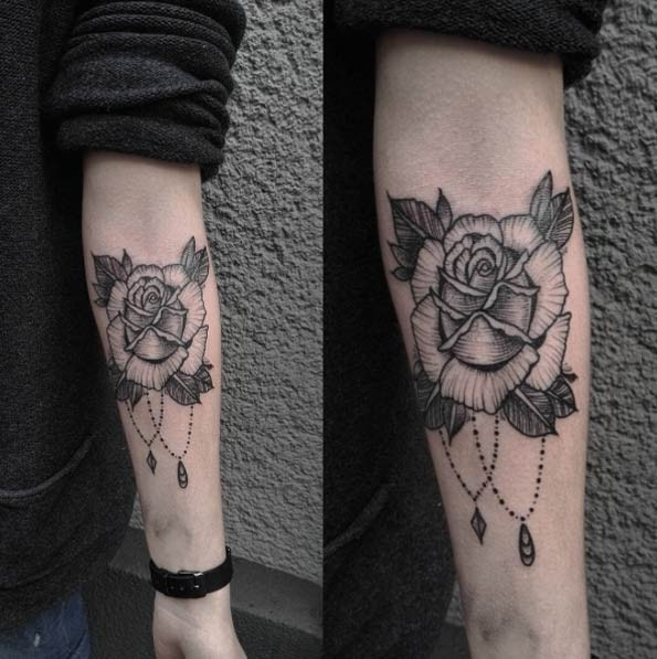 Simple black ink engraving style forearm tattoo of rose flower