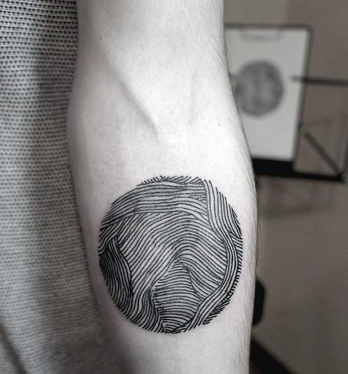 Simple black ink finger print like tattoo on arm