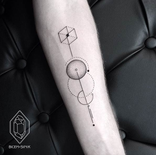 Simple black ink forearm tattoo of circle shaped figures separated by black line