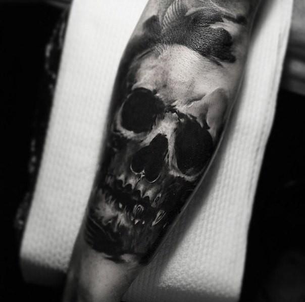 Simple black ink forearm tattoo of human skull