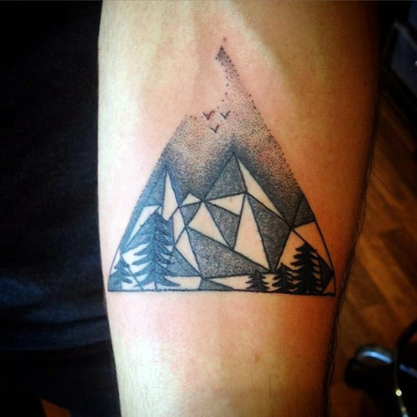 Simple black ink geometrical style mountains tattoo on arm