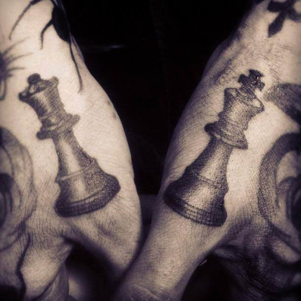 Simple black ink hands tattoo of chess figures