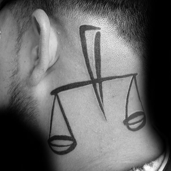 Simple black ink head tattoo of medium size libra