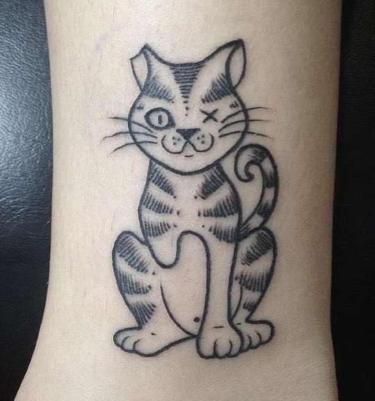 Simple black ink homemade like injured cat tattoo on leg