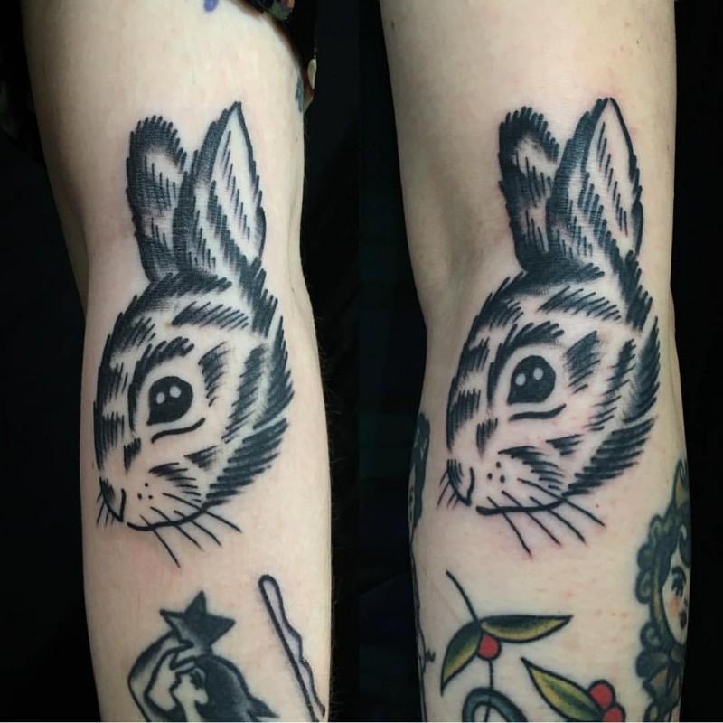Simple black ink homemade like tattoo of rabbit head