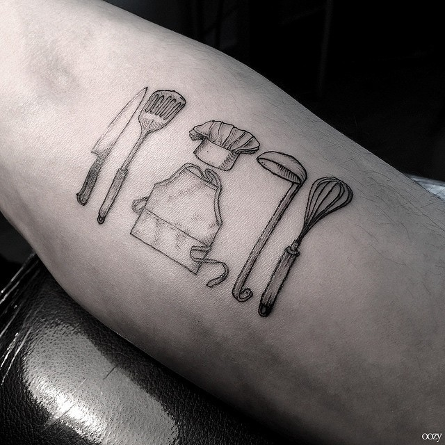 Simple black ink kitchen devices tattoo on forearm