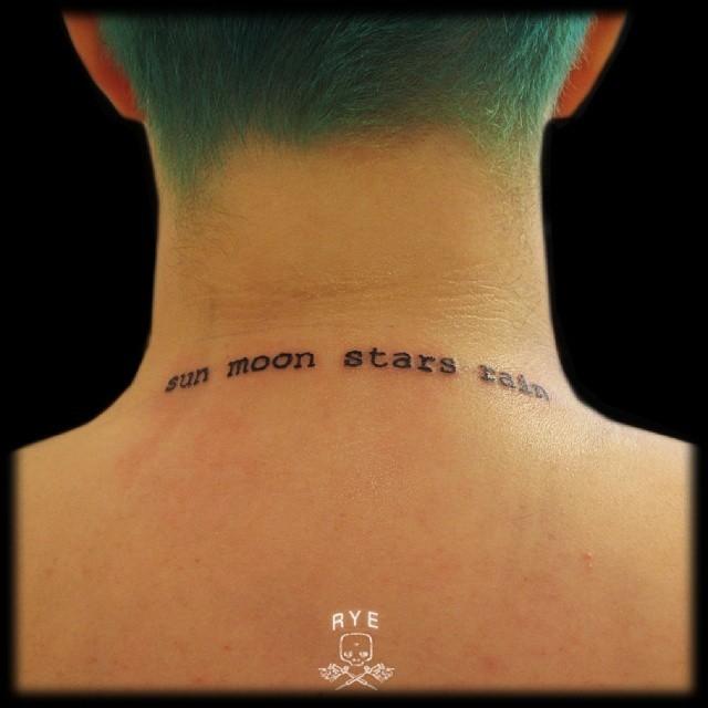 Simple black ink lettering tattoo on neck