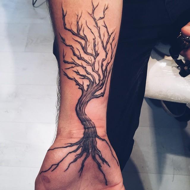 Simple black ink old creepy tree tattoo on wrist