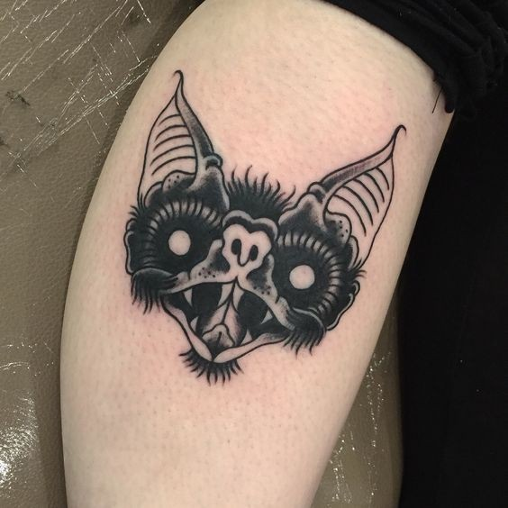 Simple black ink old school vampire bat tattoo