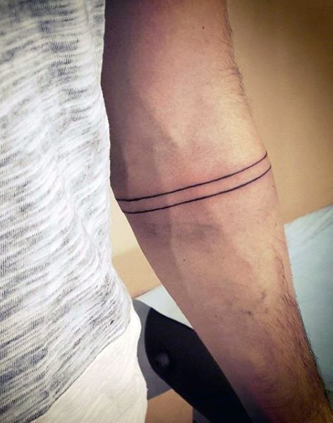 Simple black ink parallel lines tattoo on arm