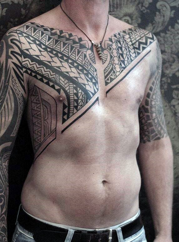 Simple black ink Polynesian style black ink tattoo on chest