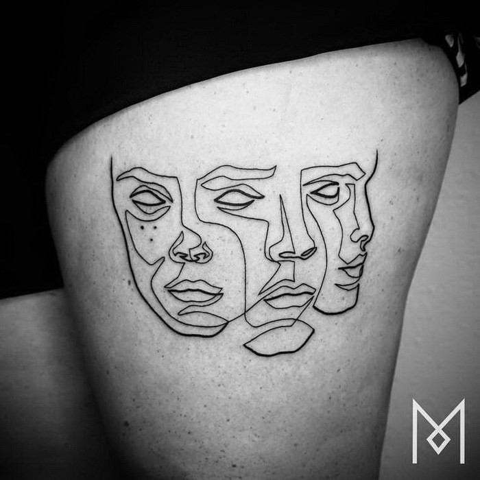 Simple black ink thigh tattoo of various masks