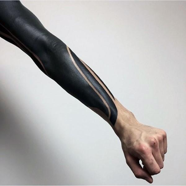 Simple black ink tribal tattoo on sleeve