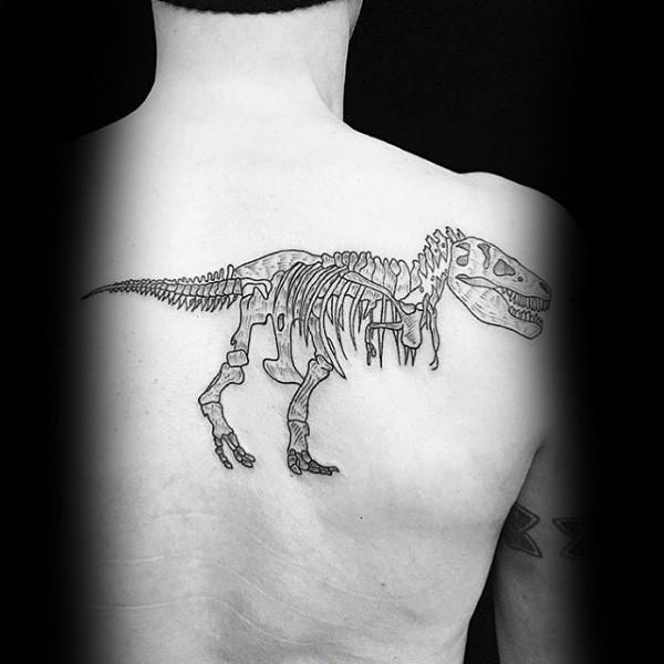 Simple black ink upper back tattoo of typical dinosaur skeleton