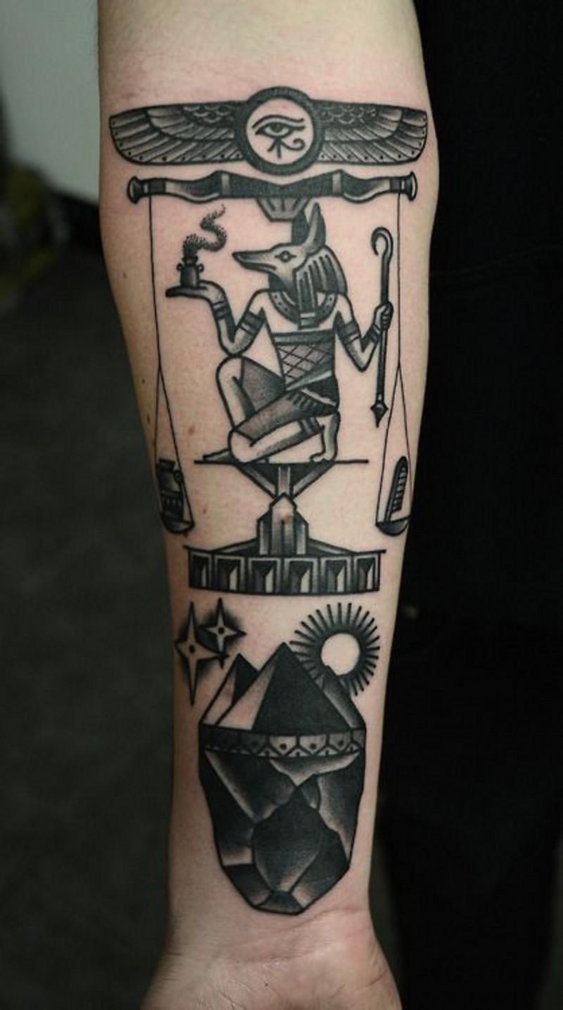 Simple black ink various symbols tattoo on arm