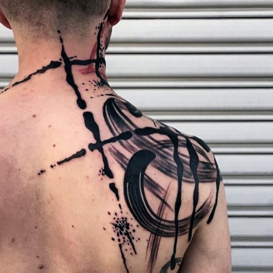 Simple blackwork style large back and shoulder tattoo of various ornaments