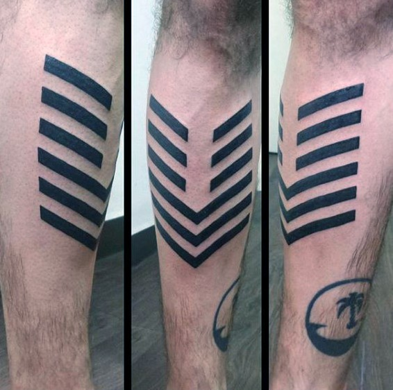 Simple blackwork style mystical symbol tattoo on leg