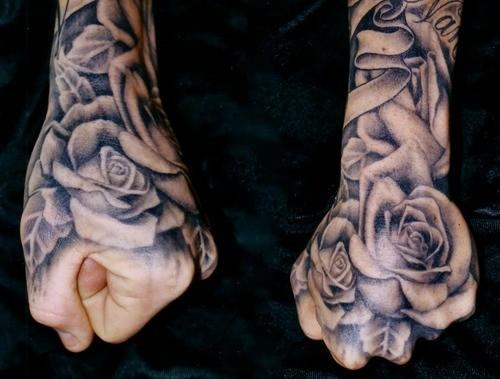 Simple Colored Big Black Ink Roses On Hand Tattoo Tattooimages Biz
