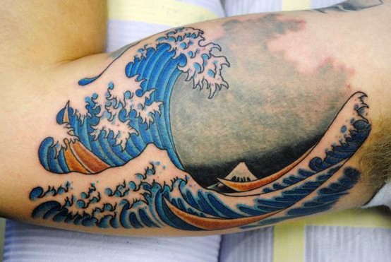 Simple colored big ocean waves tattoo on arm