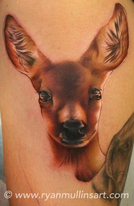 Simple colored cute deer tattoo on arm