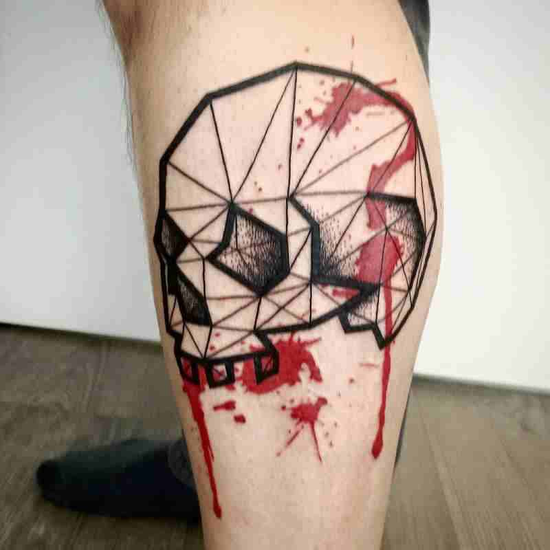 Simple colored leg tattoo of human skull with blood prints