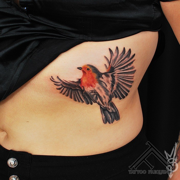 Simple colored tattoo of flying bird