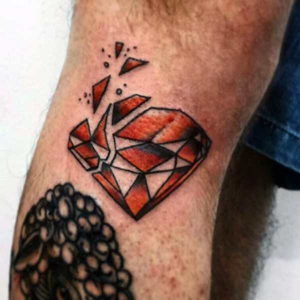 Simple designed and colored broken diamond tattoo on leg