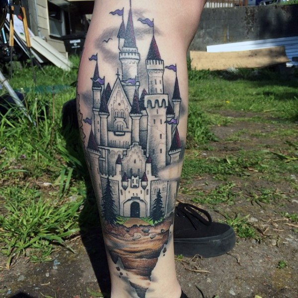 Simple designed beautiful painted colored castle tattoo on leg