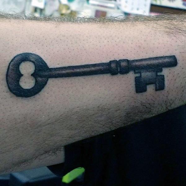 Simple designed big black ink old iron key tattoo on arm
