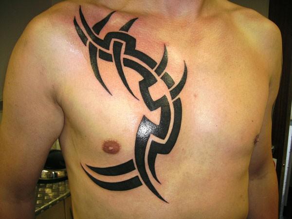Simple designed big black ink tribal ornament tattoo on chest