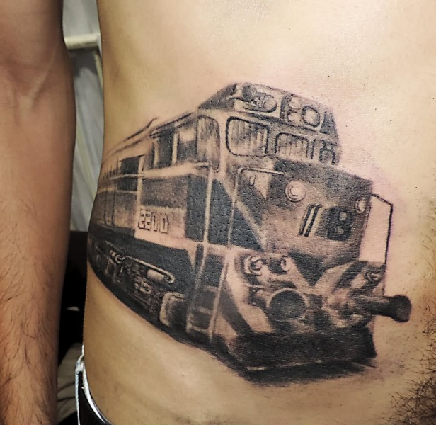 Simple designed black and white cargo train tattoo on belly